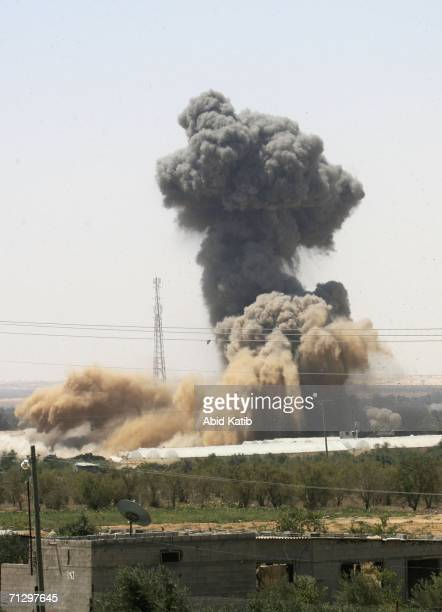 Smoke rises during a controlled explosion set off by the Israeli army to seal a tunnel used by Palestinian militants who carried out an attack on a...