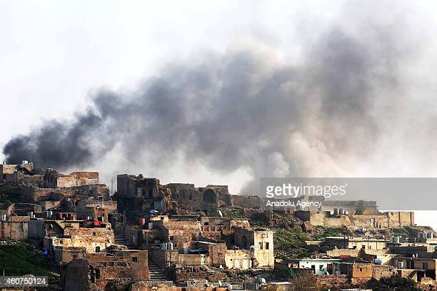 Smoke rises during the clashes between Peshmerga forces and Islamic State of Iraq and Levant fighters in Sinjar district of Mosul Iraq on December 21...