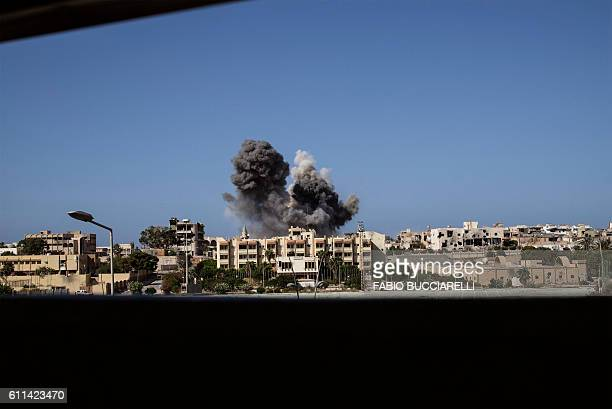 Smoke rises following a double airstrike on the District three neighbourhood of Sirte the last stronghold of Islamic State group in the coastal...
