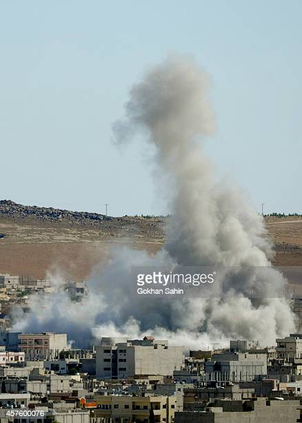 Smoke rises following an air strike by the USled coalition rises in Kobani Syria October 21 2014 as seen from a hilltop on the outskirts of Suruc...