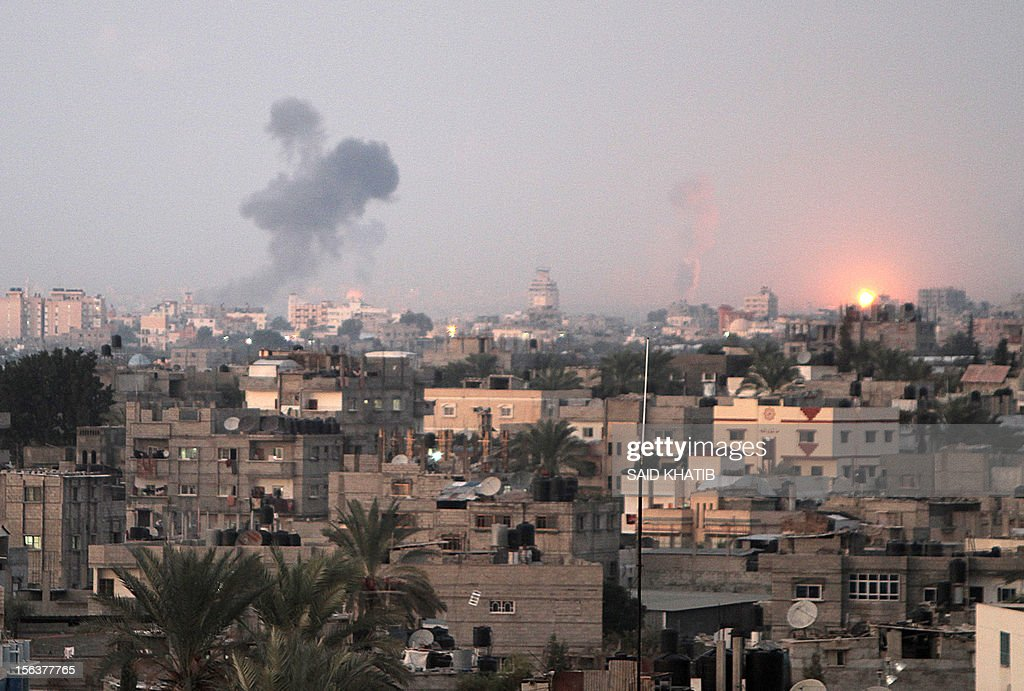 Smoke rises following an Israeli air strike in Khan Yunis, southern Gaza Strip, on November 14, 2012. An Israeli strike that killed Hamas's top commander in Gaza is only 'the beginning' of an operation to target militant groups in the strip, a military spokeswoman said.