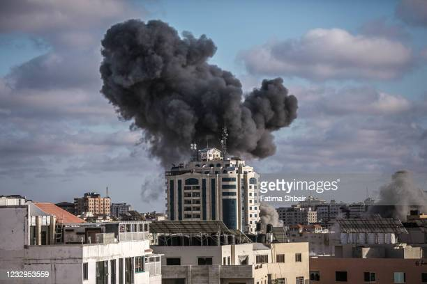 Smoke rises following an Israeli air strike on a building on May 17, 2021 in Gaza City, Gaza. More than 200 people in Gaza and ten people in Israel...