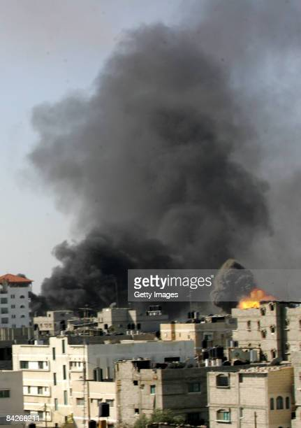 Smoke rises following an Israeli air strike on January 13 2009 in Rafah Gaza Strip Israel is intensifying its widescale ground assault against the...