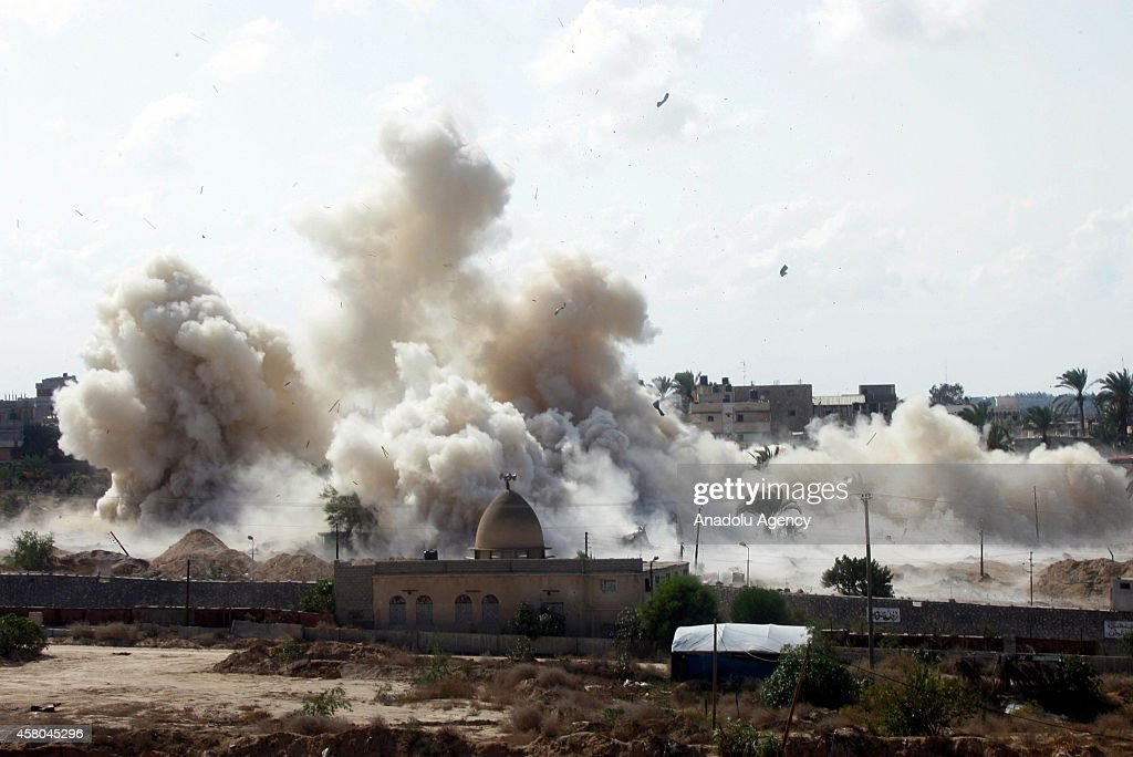 Smoke rises following houses were blown up by Egyptian security forces in Rafah near the border with southern Gaza Strip October 29, 2014. Egypt began setting up a buffer zone along the border with the Hamas-run territory to prevent militant infiltration and arms smuggling following a wave of deadly attacks after a suicide bombing in the Sinai Peninsula killed at least 26 soldiers.