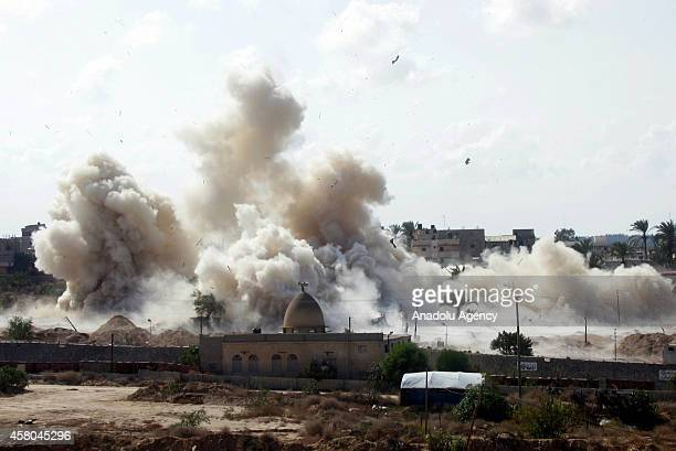 Smoke rises following houses were blown up by Egyptian security forces in Rafah near the border with southern Gaza Strip October 29 2014 Egypt began...