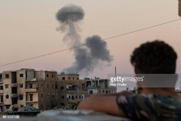 Smoke rises from a building believed to be housing ISIS, after being hit by a mortar round fired from a United States military base on August 18,...