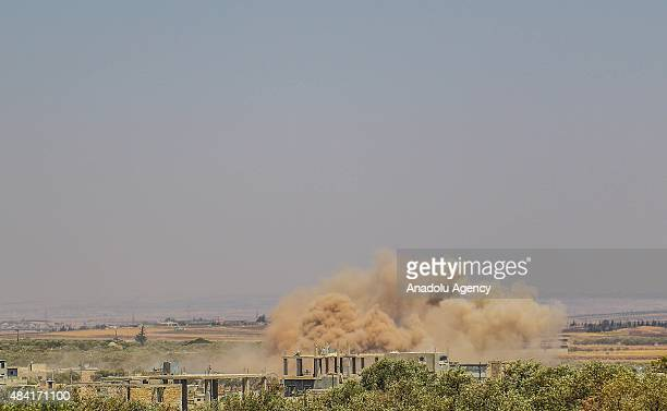 Smoke rises from a building belongs to Assad regime forces after the Syrian opposition groups linked to Ahrar al Sham troops' attack in alFua town of...