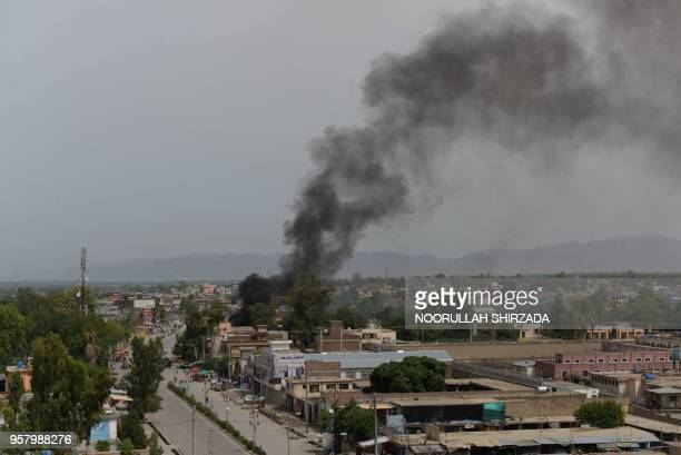 Smoke rises from a building during an ongoing attack between Afghan security force and suicide attackers at a government building in Jalalabad on May...