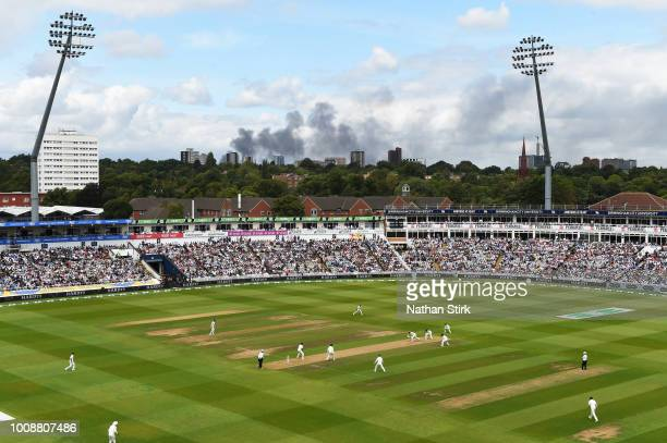 Smoke rises from a building during day one of the Specsavers 1st Test match between England and India at Edgbaston on August 1 2018 in Birmingham...