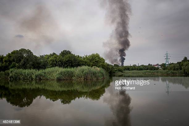 Smoke rises from a buliding damaged during fighting between proRussia rebels and Ukrainian government troops on July 21 2014 in Donetsk Ukraine Local...