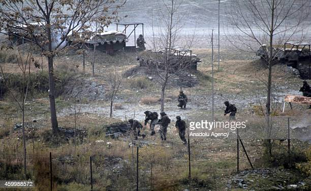 Smoke rises from a bunker as Indian Army soldiers search for suspected militants after an attack on their base at Mohra in Kashmir India on December...