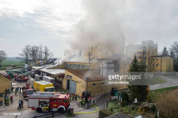 Smoke rises from a burning brewery in Irlbach, Germany, 17 April 2013. A major fire in the brewery has caused a million in damages on Tuesday night....
