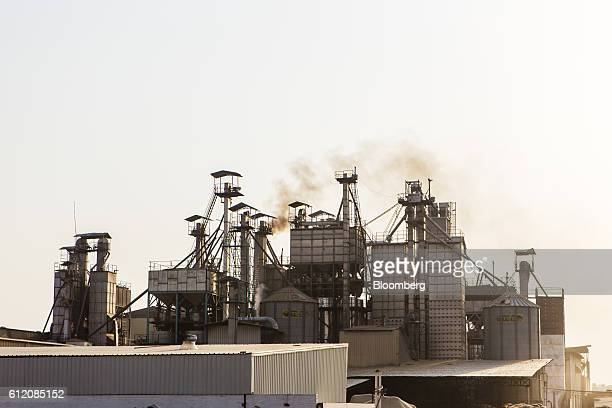 Smoke rises from a chimney at a rice mill in Karnal Haryana India on Thursday May 19 2016 A good monsoon season after two backtoback droughts will...