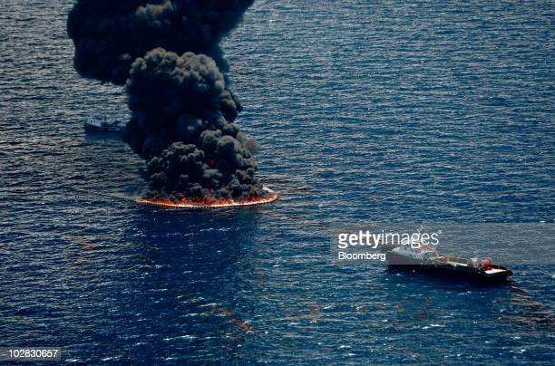 Smoke rises from a controlled burn of oil on the surface of the water near the site of the BP Plc Deepwater Horizon oil spill in the Gulf of Mexico...