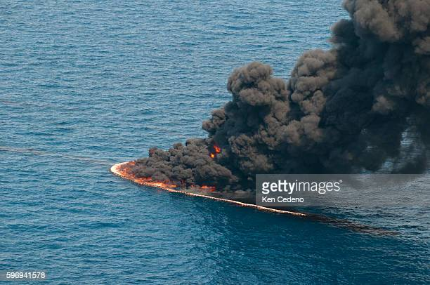Smoke rises from a controlled burn of oil on the surface of the water near the site of the BP Deepwater Horizon oil spill in the Gulf of Mexico...