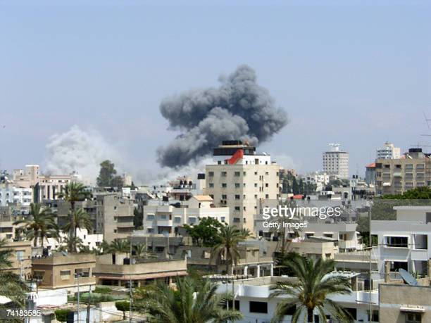Smoke rises from a destroyed building after an Israeli air strike May 17 2007 in Gaza City Gaza Strip The Israeli military said it carried out an air...