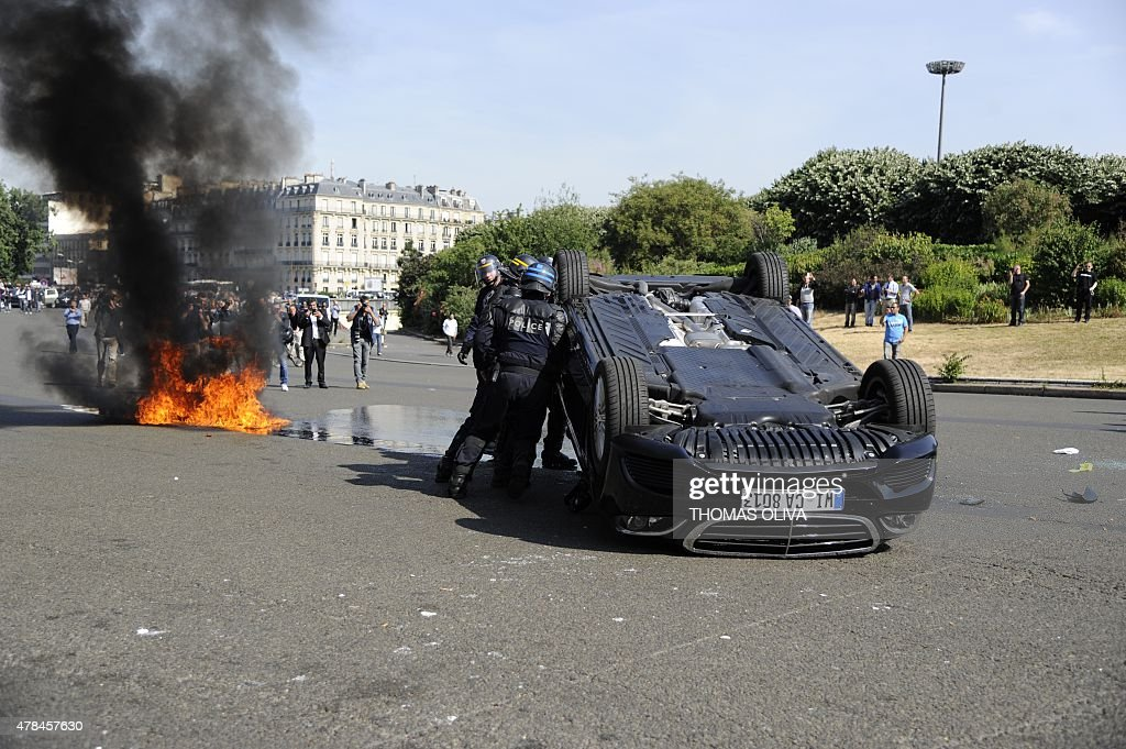 Smoke Rises From A Fire Burning Near An Overturned Car As Taxi - Taxi porte maillot