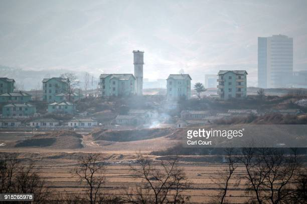 Smoke rises from a fire in a propaganda village in North Korea near the Demilitarized Zone between South and North Korea on February 7 2018 in...