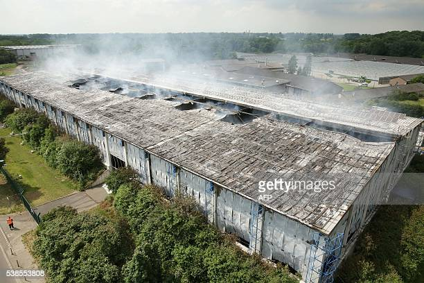 Smoke rises from a hall used as refugee shelter on June 7 2016 in Duesseldorf western Germany after a fire broke out / AFP / dpa / David Young /...