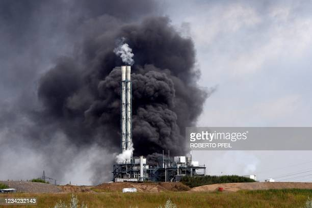 Smoke rises from a landfill and waste incineration area at the Chempark industrial park run by operator Currenta following an explosion in...