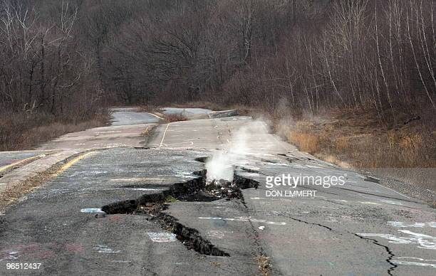 Smoke rises from a large crack in PA Highway 61 caused by the underground coal fire February 2 2010 in Centralia PA The highway now closed goes...