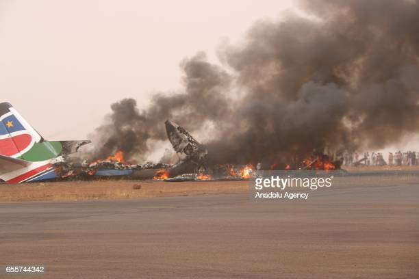 Smoke rises from a plane which took off from Juba with 44 passengers after the plane crashed while landing on Wau Airport in Wau South Sudan on March...