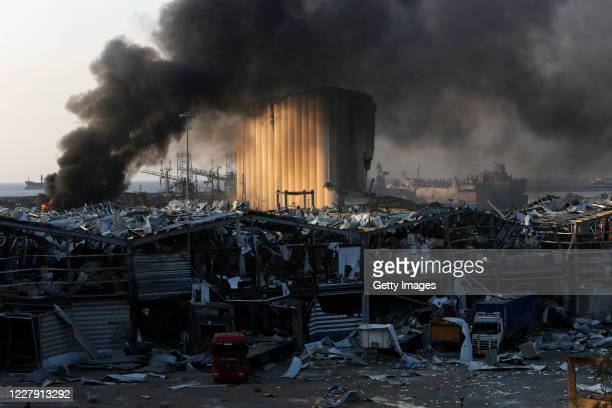 Smoke rises from a port facility after large explosions on August 4, 2020 in Beirut, Lebanon. At least 50 people were killed and thousands more...