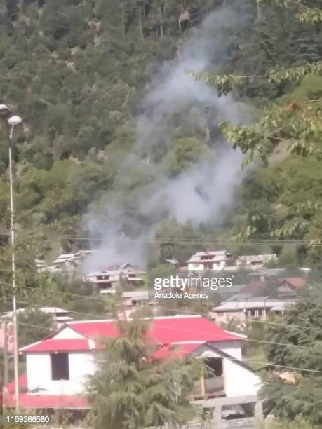 Smoke rises from a village after Indian forces attacked near Line of Control in Pakistan on August 03 2019 Pakistan Army claims that Indian forces...