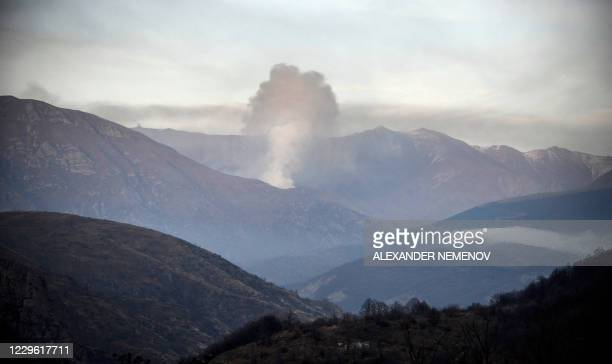 Smoke rises from a village outside the town of Kalbajar, on November 14 after a peace agreement was signed to end the military conflict between...