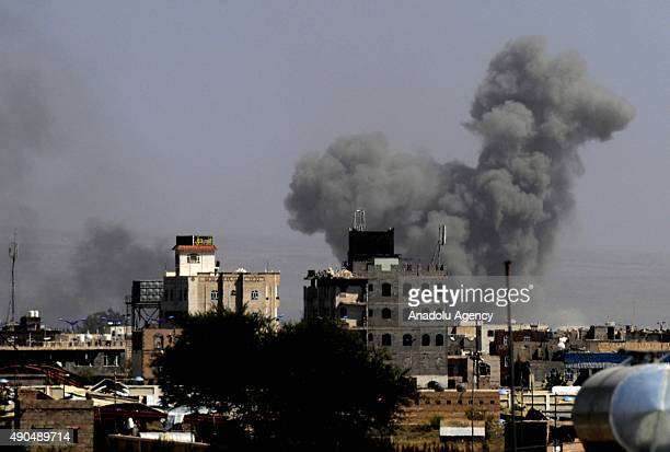 Smoke rises from al-Daylami airbase, which is under Houthi control, following the Saudi-led coalition airstrikes on September 29, 2015 in Sanaa,...