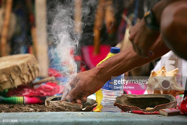 Smoke rises from an abalone shell containing burning copal that is traditionally used in Native American cleansing ceremonies and now is used by day...