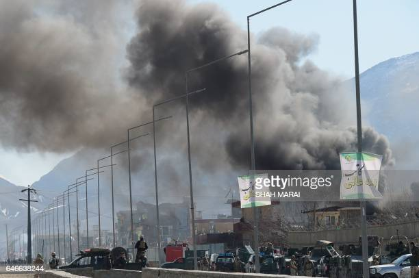 Smoke rises from an Afghan police district headquarters building after a suicide car bombing in Kabul on March 1 2017 Explosions and gunfire echoed...
