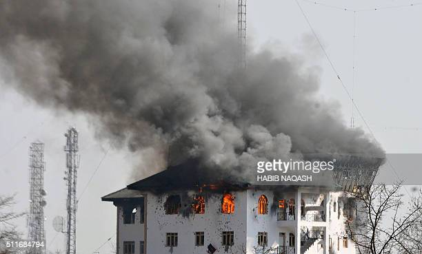 Smoke rises from an Indian government building where Kashmiri militants took refuge during an ongoing gunbattle on the outskirts of Srinagar on...