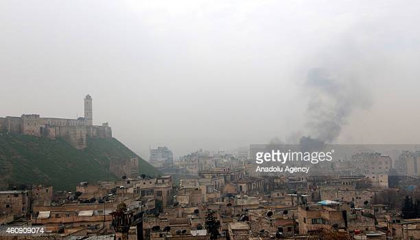 Smoke rises from around the Citadel of Aleppo after Damascus Front forces attack to regime forces in Aleppo Syria on December 30 2014 Damascus Front...