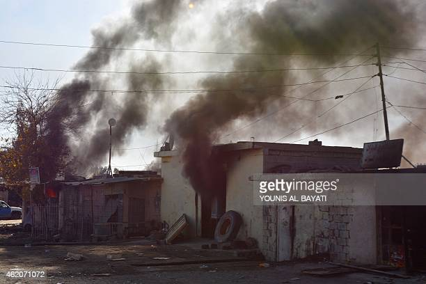 Smoke rises from buildings during the second day of a military operation launched by the Iraqi army supported by progovernment militia to retake...