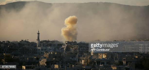 Smoke rises from buildings following a reported strike on a rebelheld area of the Jobar district east of the Syrian capital on November 11 2017 / AFP...
