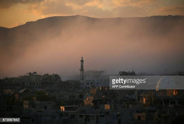 TOPSHOT Smoke rises from buildings following a reported strike on a rebelheld area of the Jobar district east of the Syrian capital on November 11...
