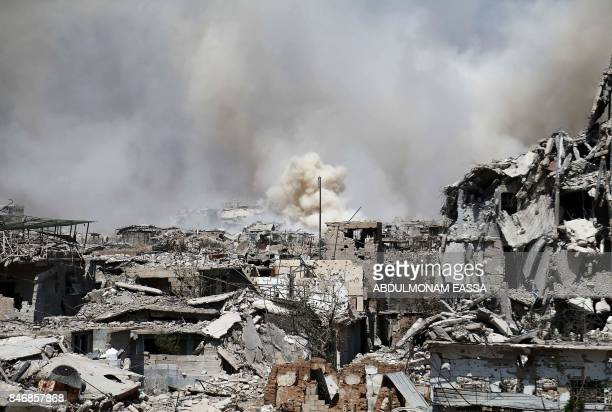 Smoke rises from buildings following a strike on a rebelheld area of the Jobar district east of the Syrian capital on September 14 2017