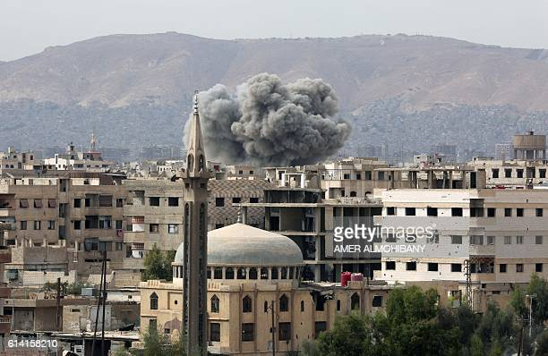 Smoke rises from buildings following air strikes on Damascus' rebelheld eastern suburb of Zamalka on October 12 2016 ALMOHIBANY