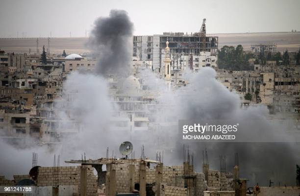 Smoke rises from buildings in a rebelheld neighbourhood of Daraa in southern Syria following reported shelling by the regime on May 22 2018
