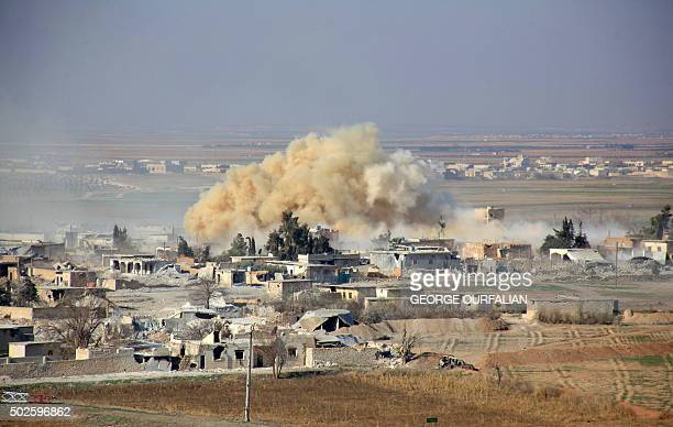 Smoke rises from buildings in the area of Tal Sharba following government air strikes on the outskirts of the northern Syrian city of Aleppo on...