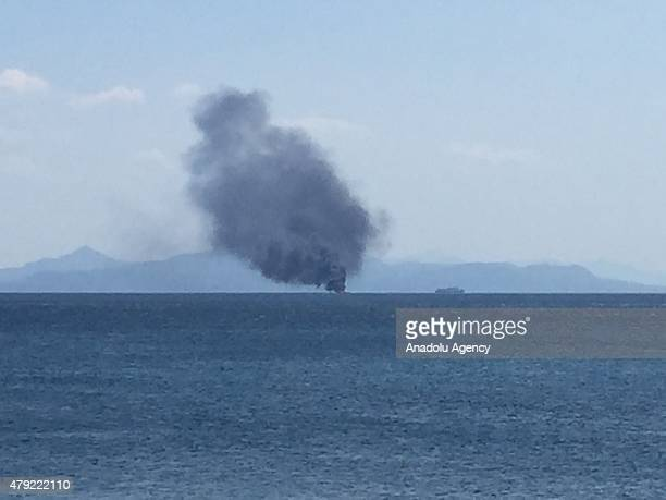 Smoke rises from burning Ocean V ship offshore the port of Pire in Athens Greece on July 2 2015