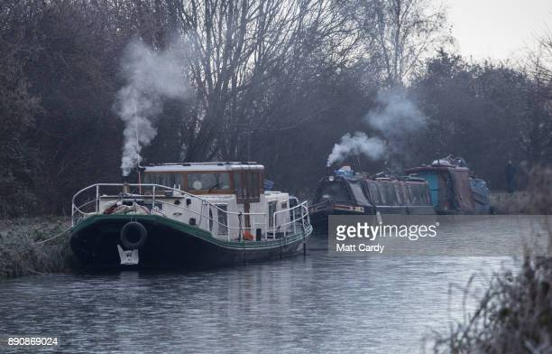 Smoke rises from canal boats on the Kennet and Avon canal on December 12 2017 near Bath England Last night the UK had the coldest night of the year...