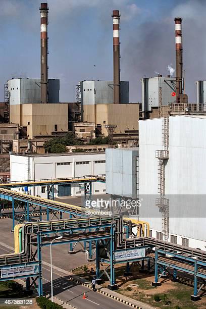Smoke rises from chimneys at the Bin Qasim Power Station II plant operated by KElectric Ltd in the Bin Qasim Town area of Karachi Pakistan on...