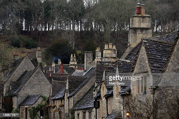 Smoke rises from chimneys on houses in the centre of the village of Castle Combe that was recently featured in Steven Spielberg's latest film the...