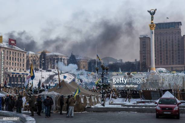 Smoke rises from clashes between antigovernment protesters and police on Hrushevskoho Street near Dynamo stadium as seen from Independence Square on...