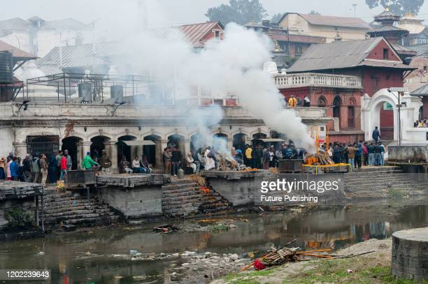Smoke rises from cremation ghats by the Bagmati river at the Pashupatinath temple complex one of the holiest shrines of the Hindus as well as UNESCO...
