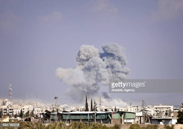 """Smoke rises from Daesh positions as Members of Free Syrian Army advance towards the center of al-Bab town of Aleppo during the """"Operation Euphrates..."""