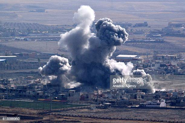Smoke rises from Daesh terrorists' targets at Bashiqa town following coalitions forces airstrike during the operation to retake Iraq's Mosul from...