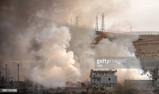 TOPSHOT Smoke rises from damaged police headquarters after a suicide truck bombing killed eleven Turkish police officers and injured 78 people on...